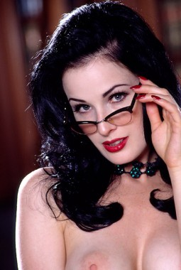 Dita Von Teese wearing glasses and showing her nipples