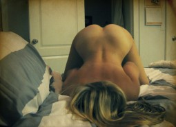 woman ass up on a bed waiting and offering