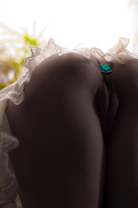 ass up woman with jeweled buttplug inserted in her ass
