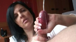 Klixen using two hands to edge a cock into a cumshot