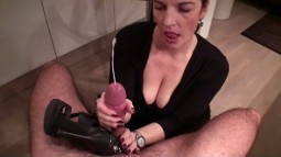 Klixen wearing a low cut black top showing major cleavage while pumping a cock into a cumshot