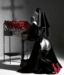 nun kneeling in penance in front of a bank of votive candles with her habit parted to show her bare ass