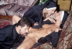 nun laying back with her habit open and legs spread while a priest licks her pussy and another nun whispers to her