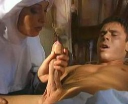 nun in habit giving handjob to reclining naked man