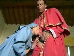cardinal with his robe pulled apart and nun kneeling and giving him a blowjob