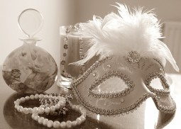 Mask, pearls and perfume on a dressing table