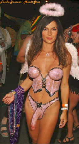 image of pretty tranny walking Bourbon Street in Mardi Gras with body painted lingerie, nice tits and big cock