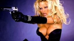girls-with-guns-Pamela-Anderson-cleavage-handgun