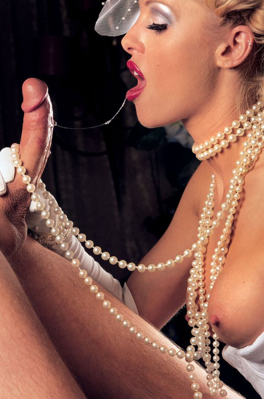 topless bride wearing pearl necklace ropes sucking a cock